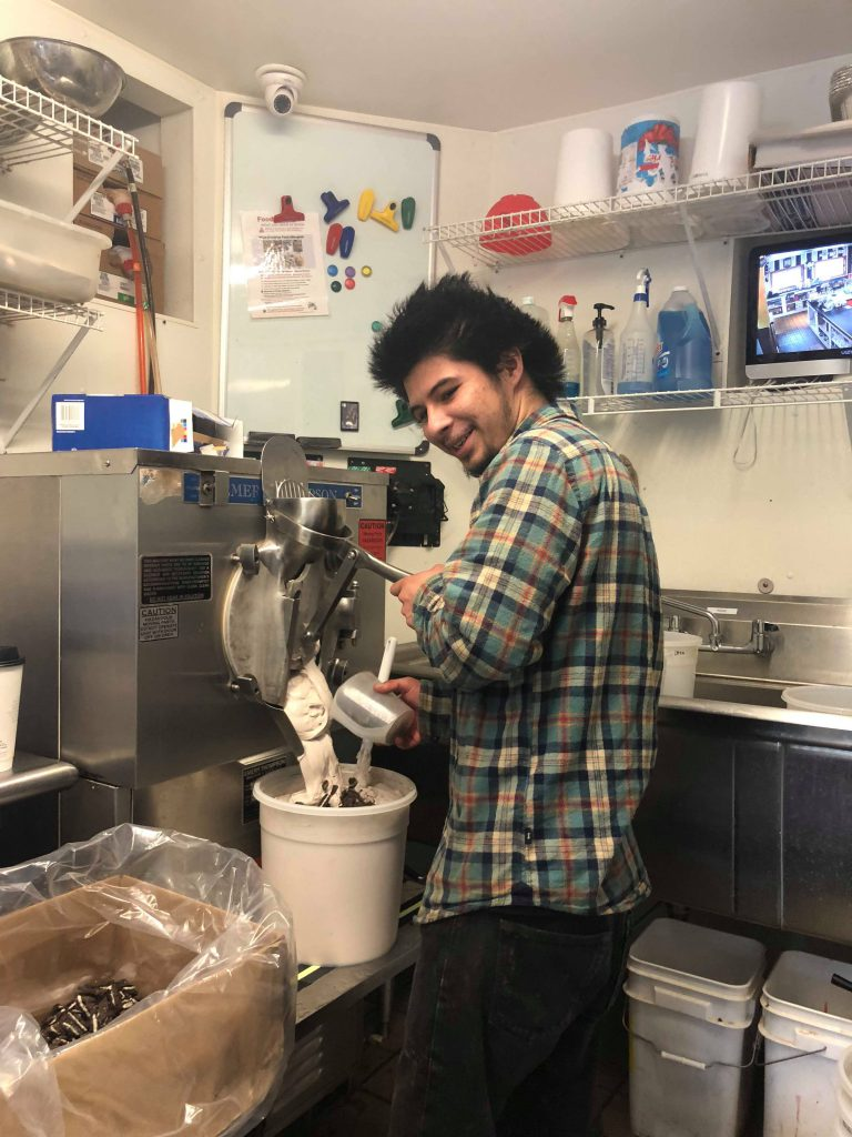 Young man making ice cream