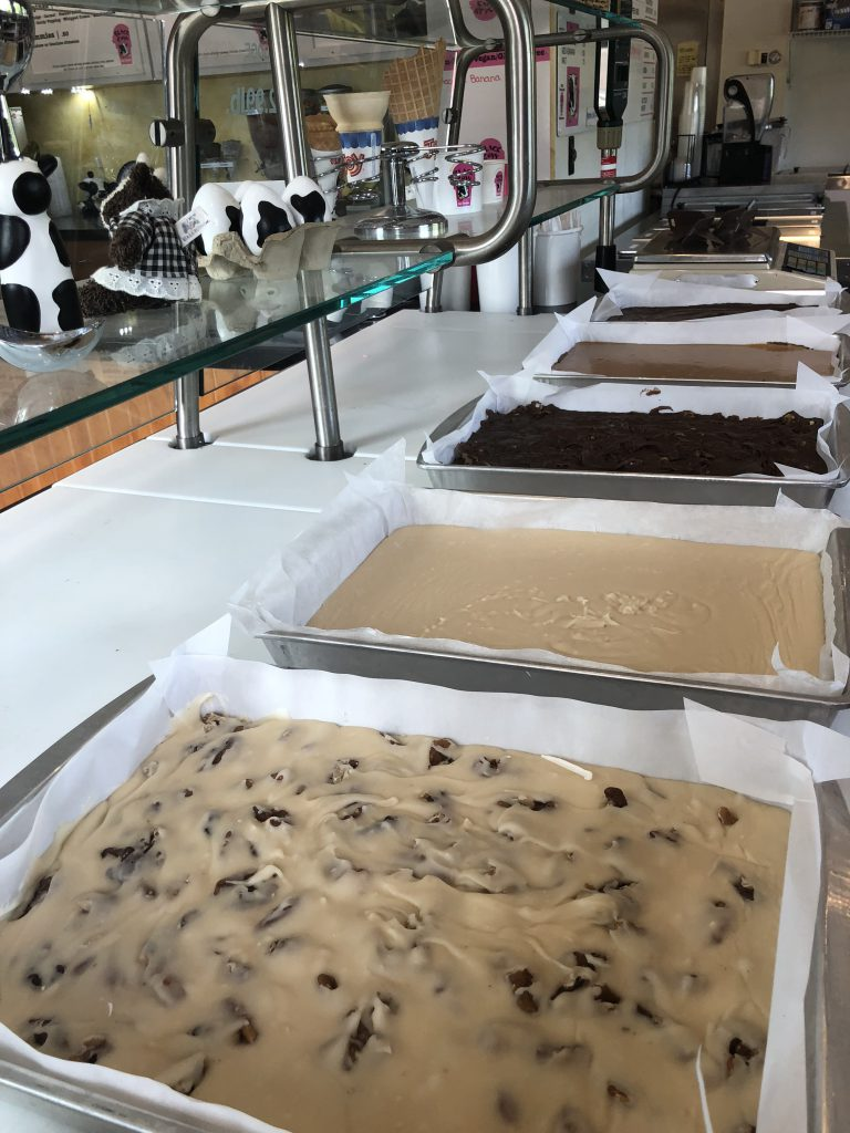 Large trays of homemade fudge on a countertop